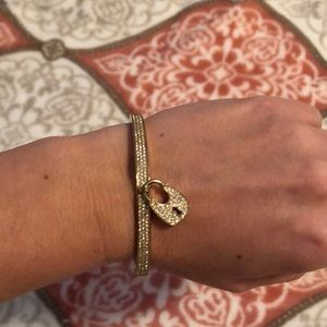 Michael Kors bangle with lock crystal accent